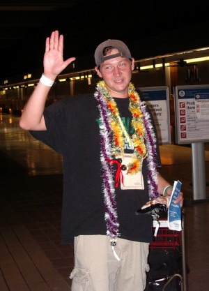 Intern Pastor Josh waves good-bye at the airport