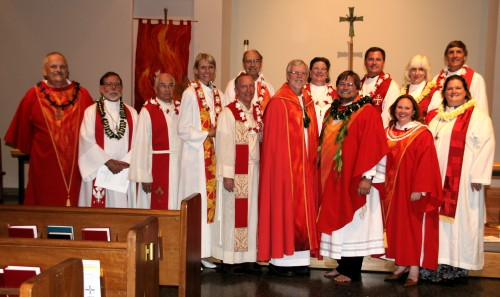 The clergy at the installation all dressed in red