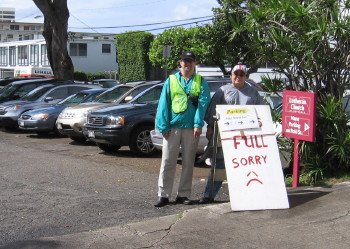 Lars Tellander and Cheryl Crosier-Garcia during Punahou Carnival Parking, watching over the full back lot.