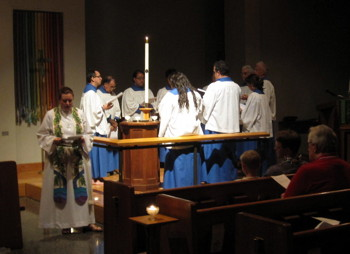 Pastor Angela Freeman leads the prayers and the choir leads the responses during Evening Prayer