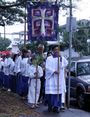Jerome leads the Palm Sunday procession around the church