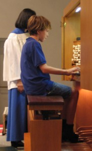 Jordan M. plays the Beckerath organ for Children's Sabbath