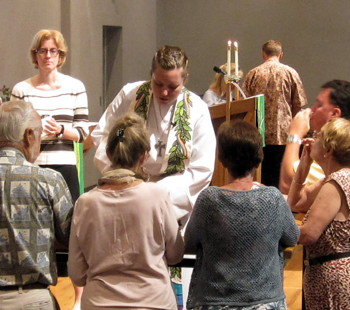 Pastor Jeff Angela Freeman distributes communion at the altar rail.